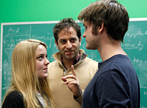 faculty member Michael Goldfried standing in between two actors facing eachtother, presumably giving them directions.