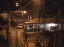 Screenshot of Maya's film showing a car driving along a road at night