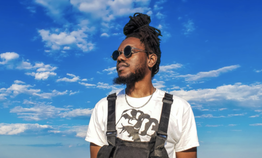 profile photo of Sage Love in front of a cloudy blue sky