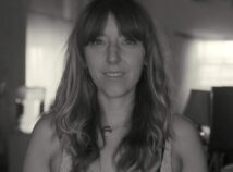Profile Photo of BFA Film faculty memeber CorTney Collins. Black and white photo of woman smiling at camera