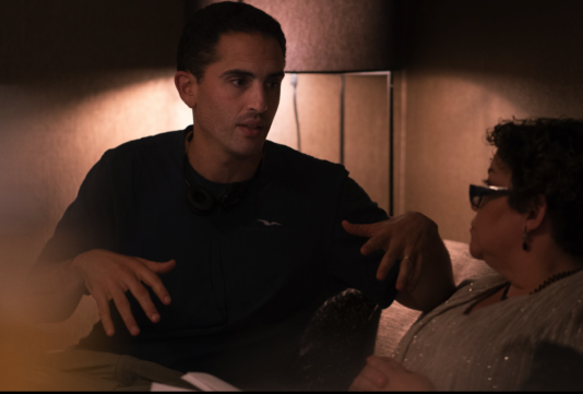 Director Daniel Poliner sits with actress Sol Miranda discussing a scene they are about to shoot.